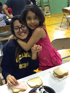 Making sandwiches for the homeless with our mentors from Schurz High School